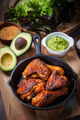 Grilled chicken legs and wings with guacamole - PhotoDune Item for Sale
