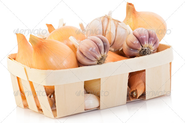 Garlic and onion at wooden basket - Stock Photo - Images