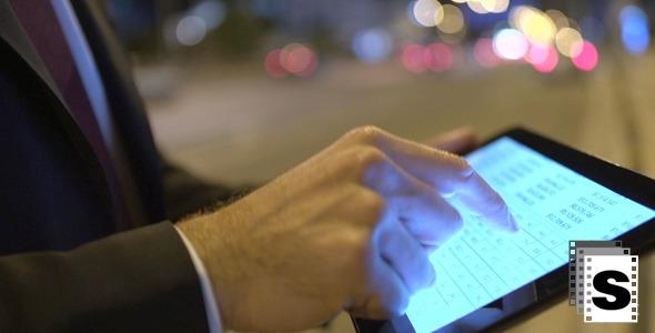 Using Digital Tablet On Street