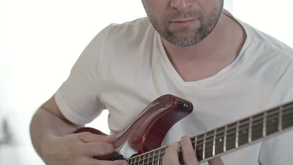 Download Man Playing Guitar at Home nulled download