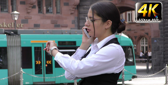 Business Woman Talking to Cellphone in City