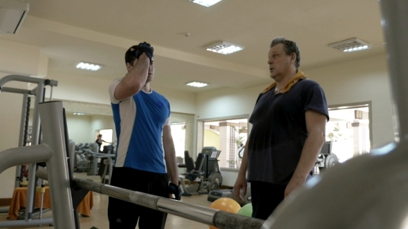 Gym Instructor Giving Consultation To a Man