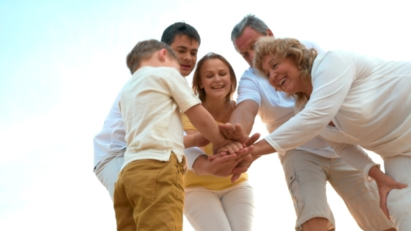 Close-Knit Family Putting Hands Together