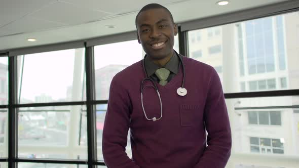 A Black Male Medical Professional Walks Up To The Camera 1 Of 5