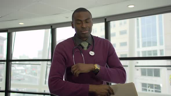 A Black Male Medical Professional Walks Up To The Camera 2 Of 5