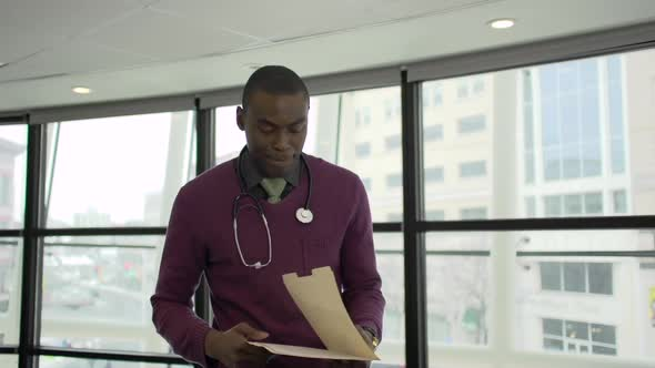 A Black Male Medical Professional Walks Up To The Camera 4 Of 5
