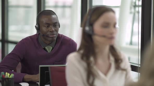A Black Man Works In A Attractive Modern Call Center 1 Of 4