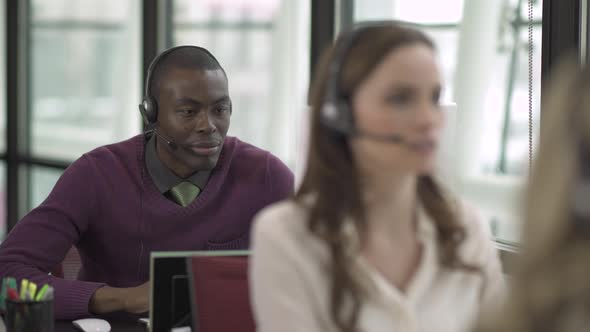 A Black Man Works In A Attractive Modern Call Center 2 Of 4