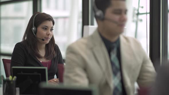 A Mixed Race Woman Works In A Attractive Modern Call Center 5 Of 6