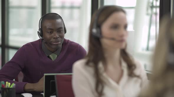 A Black Man Works In A Attractive Modern Call Center 4 Of 4