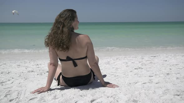 Woman Relaxing On A Morning Beach 5 Of 9