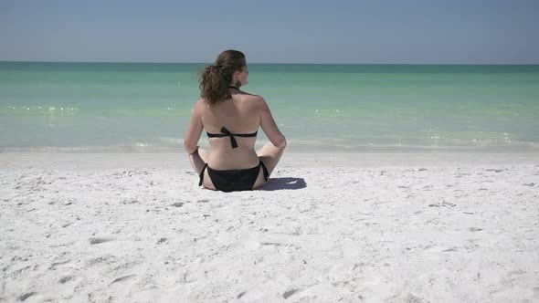 Woman Relaxing On A Morning Beach 9 Of 9