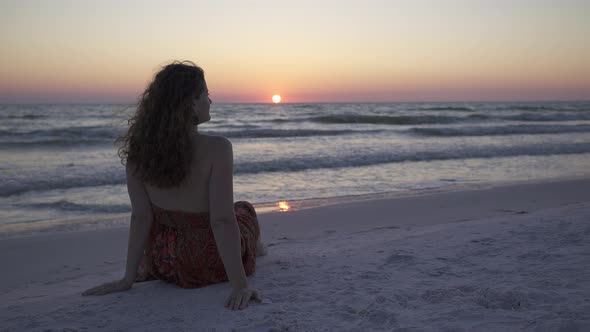 VideoHive Woman Relaxing On Beach At Sunset 1 Of 4 12008904