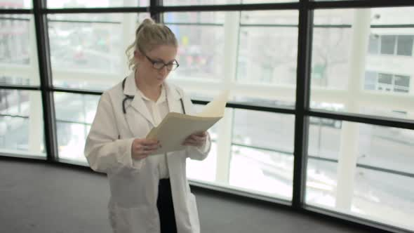 A Blonde Caucasian Female Medical Professional Walks Up To The Camera 4 Of 4