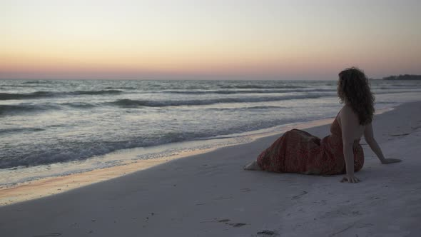 VideoHive Woman Relaxing On Beach At Sunset 3 Of 4 12008913