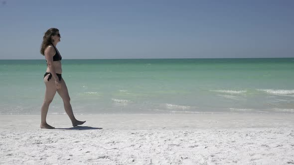 Woman Walking On A Morning Beach 1 Of 2