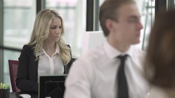 A Blonde Caucasian Woman Works In A Attractive Modern Office 1 Of 2