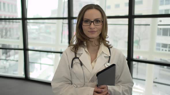 A Caucasian Female Medical Professional Walks Up To The Camera 2 Of 9