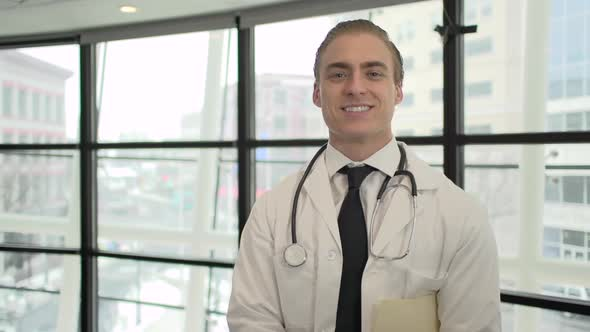 A Caucasian Male Medical Professional Walks Up To The Camera 10 Of 10