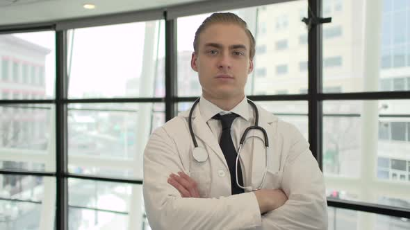 A Caucasian Male Medical Professional Walks Up To The Camera 3 Of 10