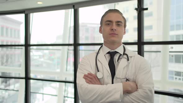 A Caucasian Male Medical Professional Walks Up To The Camera 5 Of 10