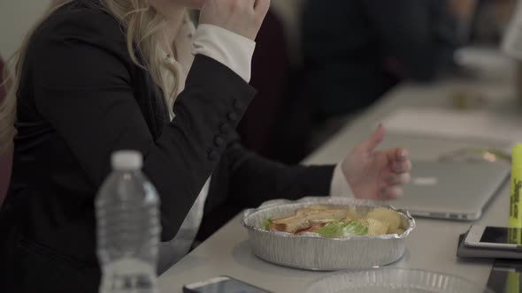 A Professional Eating In A Networking Meeting 1 Of 2 1