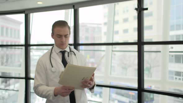 A Caucasian Male Medical Professional Walks Up To The Camera 6 Of 10