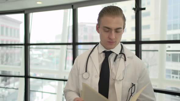A Caucasian Male Medical Professional Walks Up To The Camera 8 Of 10