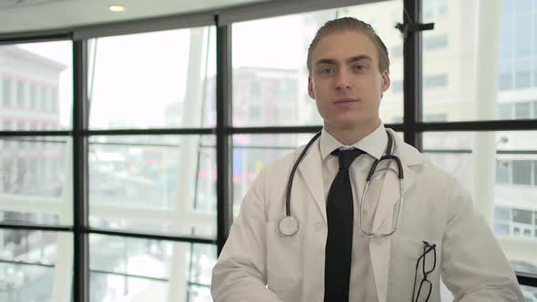 A Caucasian Male Medical Professional Walks Up To The Camera 9 Of 10