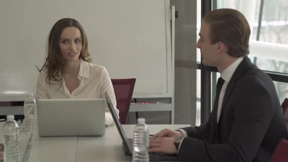 A Professional Man And Woman In A Meeting 10 Of 13