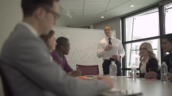 A Caucasian Man Leading A Meeting 1 Of 7