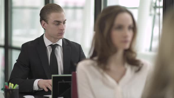 A Caucasian Man Works In A Attractive Modern Office 1 Of 5
