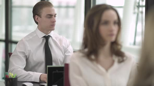 A Caucasian Man Works In A Attractive Modern Office 3 Of 5