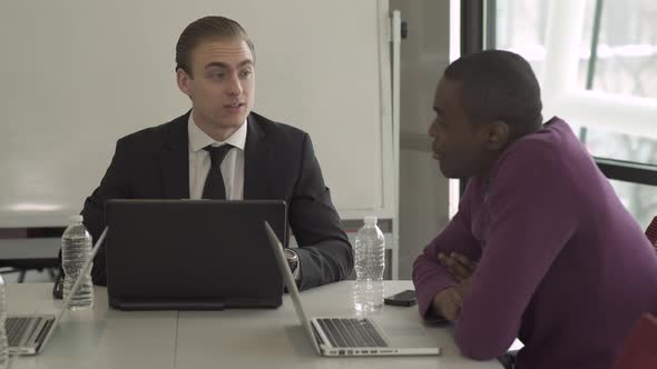 Two Professional Men In A Meeting 3 Of 4