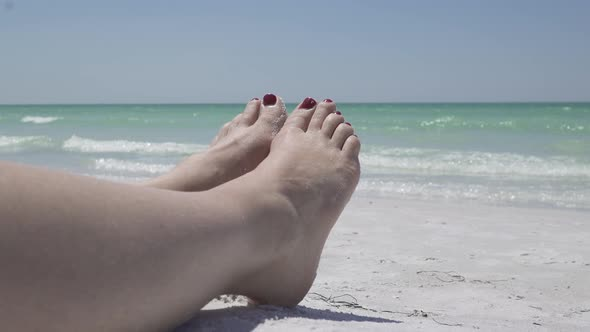 View Of Feet Relaxing On The Beach 4 Of 4