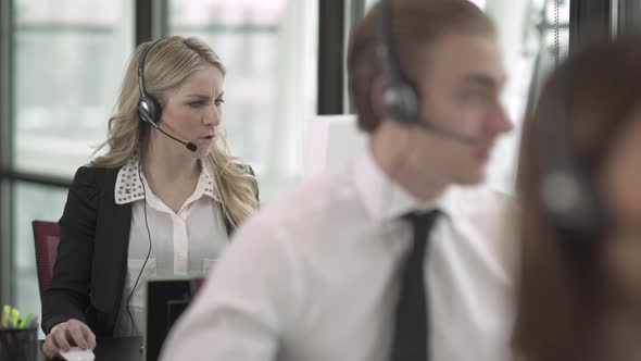 Blonde Caucasian Woman Works In A Attractive Modern Call Center 1 Of 3