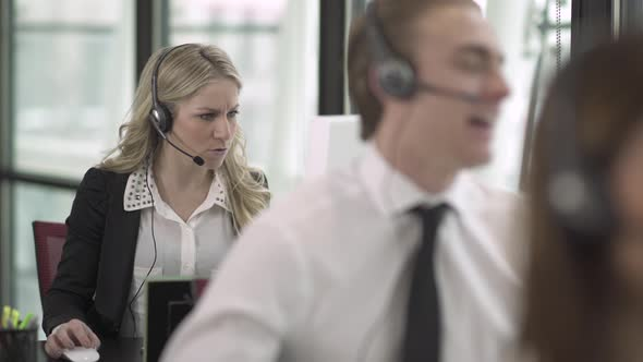 Blonde Caucasian Woman Works In A Attractive Modern Call Center 2 Of 3