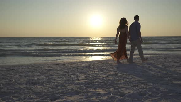 Couple Walking On Beach At Sunset 14 Of 23