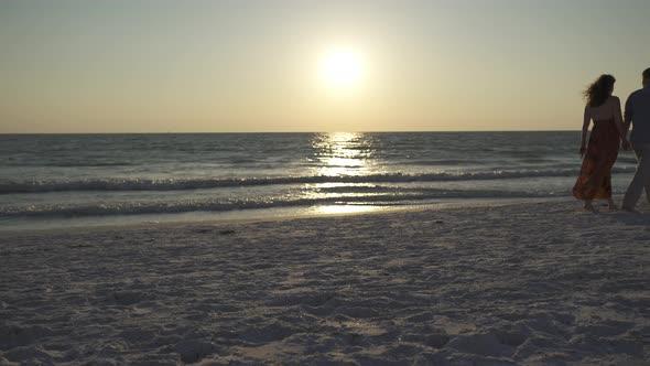 Couple Walking On Beach At Sunset 2 Of 23