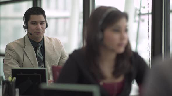 Hispanic Man Works In A Attractive Modern Call Center 3 Of 4