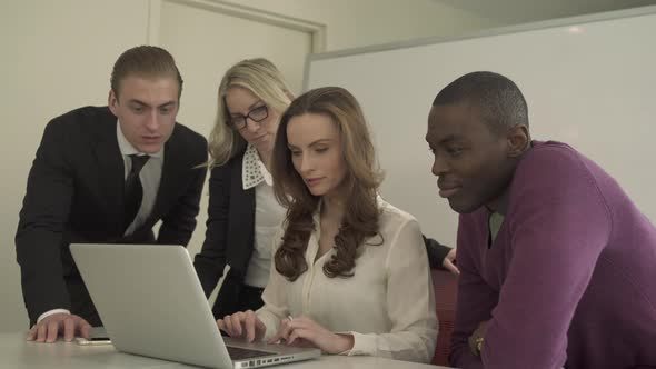 Professionals Looking At Laptop 5 Of 5