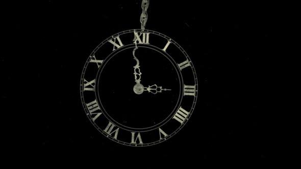 Classic Clock Swinging On Chain