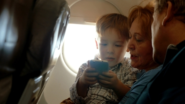 He Has a Good Flight With Grandparents And Cell