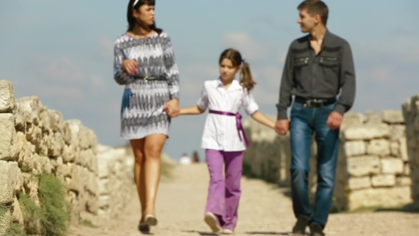 Family Of Three People Walking In The Historical