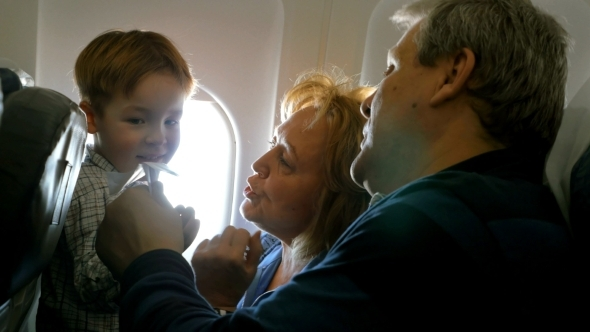 Grandparents And Little Grandson Traveling By