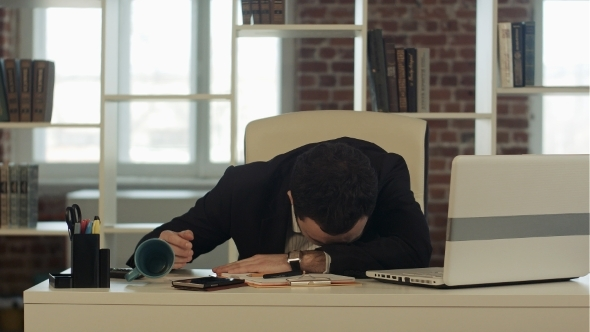 Tired Businessman Sleeping With Laptop Wake Up