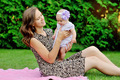 Beautiful Mother And Baby playing in a park. outdoors. Nature. B