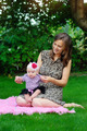 family, child and parenthood concept - happy mother holding and