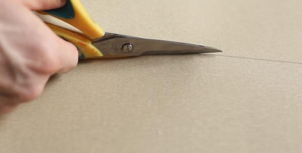 Man Cuts Canvas