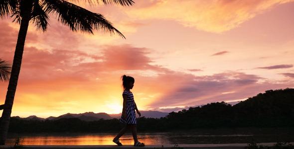 Little Girls Walking In Sunset